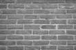 Leinwanddruck Bild - Abstract Wall black brick wall texture background pattern, brick surface backgrounds. Vintage Brickwork or stonework flooring interior rock old clean concrete grid uneven, wallpaper bricks design.