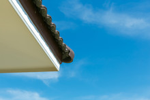 House's Top Roof Under Blue Sky.