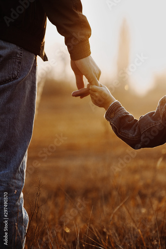 Obraz Colse up view of father and son hands - fototapety do salonu