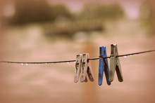 Plastic Clothespins On Wet Wir...