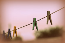 Plastic Clothespins On Wet Wir...