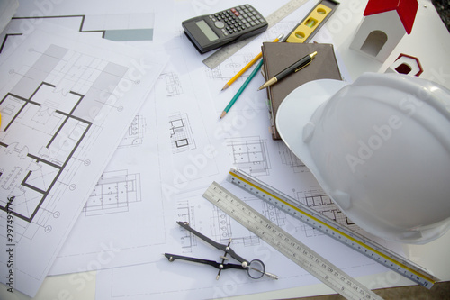 Desk of Architectural working project in construction site,With drawing equipment concept - 297495776