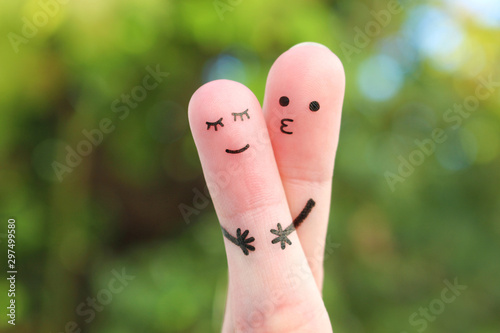 Photo Fingers art of Happy couple. Man hugs and kisses woman.