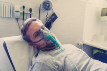 Sick Man With Oxygen Mask In E...
