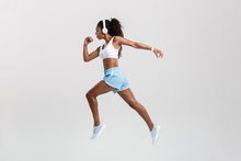 Confident Young Fit African Sportswoman Listening To Music