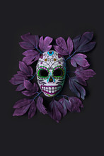 Sugar Skull Mask With Flowers Used For Celebrating Day Of The Dead In Hispanic Culture. Mexican Symbol Of The Traditional Dia De Los Muertos.