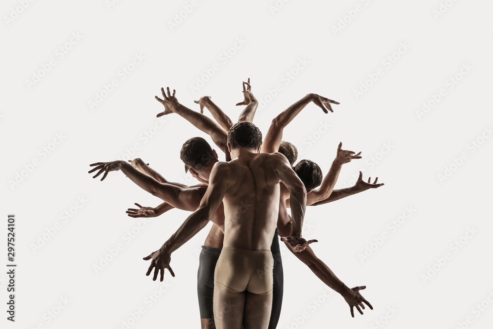 Fototapeta The group of modern ballet dancers. Contemporary art ballet. Young flexible athletic men and women in ballet tights. Studio shot isolated on white background. Negative space.