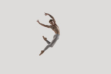 Modern Ballet Dancer. Contemporary Art Ballet. Young Flexible Athletic Man.. Studio Shot Isolated On White Background. Negative Space.