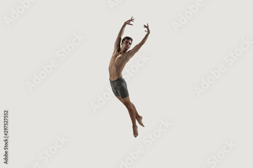 Keuken foto achterwand Gymnastiek Modern ballet dancer. Contemporary art ballet. Young flexible athletic man.. Studio shot isolated on white background. Negative space.