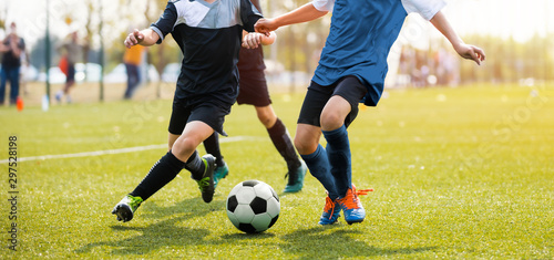 Two soccer players running and kicking a soccer ball Tablou Canvas