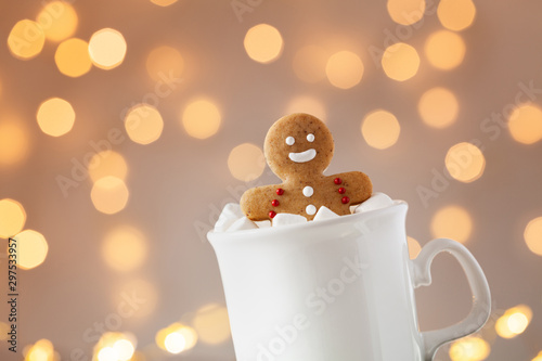 Gingerbread man in cup of hot cocoa with marshmallow. Christmas cookie.