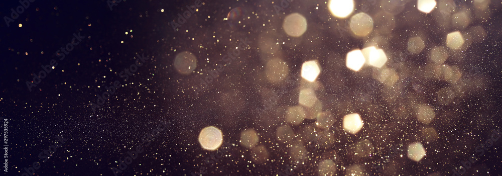Fototapeta background of abstract glitter lights. gold and black. de focused. banner