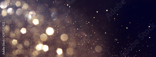 Fototapeta background of abstract glitter lights. gold and black. de focused. banner obraz na płótnie