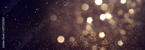 Poster Wall Decor With Your Own Photos background of abstract glitter lights. gold and black. de focused. banner