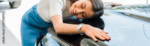 panoramic shot of happy girl with closed eyes near black car Canvas-taulu
