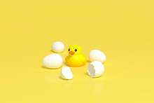 Yellow Little Duck Doll, Yellow Rubber Duck Doll, Duck Bath Toy, Baby Toy On Yellow Background 3d Rendering. Duckling Toy Hatch From Eggs 3d Illustration Minimal Style Concept.