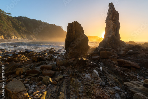 Playa del Silencio beach at sunset, Cudillero in Asturias, Spain Wallpaper Mural