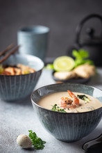 Tom Yum Kung Soup, A Thai Traditional Spicy Prawn Soup In A Bowl On Gray Background