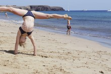 Girl Gymnast On Beach