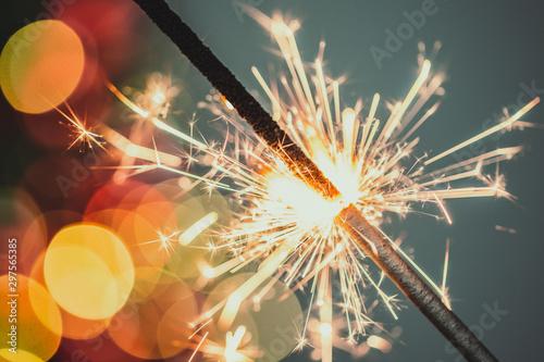 Keuken foto achterwand Vuur Close-up of holiday Christmas sparkler on dark background