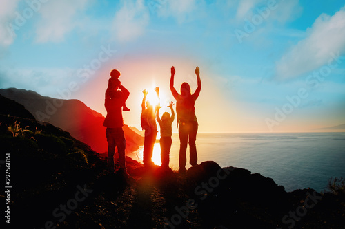 happy family with kids travel in mountains at sunset