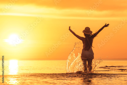 Fototapeta Beautiful sunset and slim girl at the beach obraz