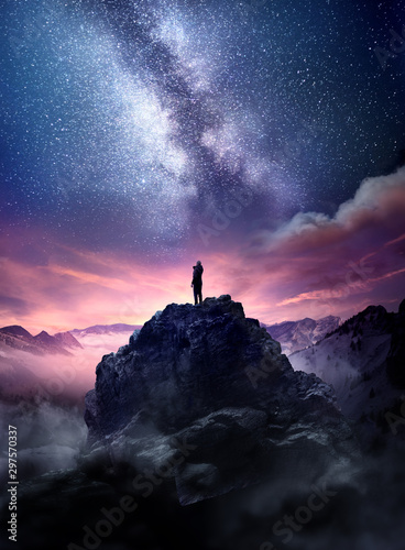 night-sky-long-exposure-landscape-a-man-standing-on-a-high-rock-watching-the-stars-rise-into-the-night-sky-photo-composite