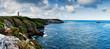 Leinwandbild Motiv panorama coastal landscape with cliffs and a lighthouse