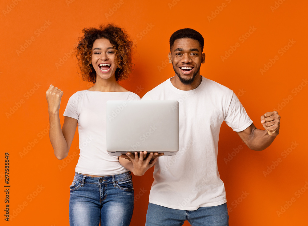 Fototapety, obrazy: Cheerful black millennial couple with laptop screaming