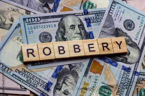 Valokuvatapetti The word robbery on dollar usa background