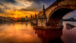 Leinwanddruck Bild - Charles bridge (Karluv most) at sunrise, scenic view of the Old town with Old Town Bridge Tower, colorful sky and historic medieval architecture, Prague, Czech Republic. Holidays in Prague