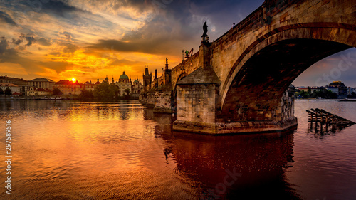Obraz Charles bridge (Karluv most) at sunrise, scenic view of the Old town with Old Town Bridge Tower, colorful sky and historic medieval architecture, Prague, Czech Republic. Holidays in Prague - fototapety do salonu