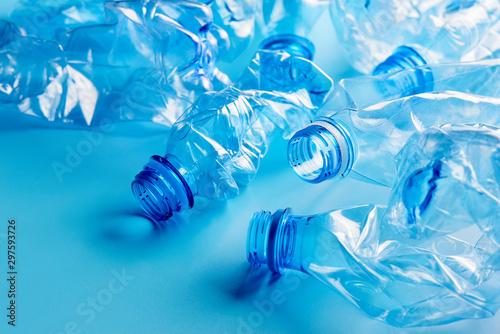 Obraz na plátne Empty crumpled plastic bottles pattern blue background