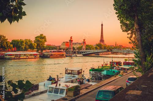 Tablou Canvas Sunset view of  Eiffel Tower, Alexander III Bridge and river Seine in Paris, France