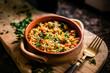 Leinwandbild Motiv A bowl of paella in wood