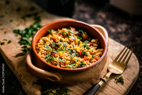 A bowl of paella in wood - 297605161