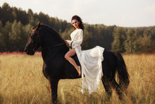 Girl In A Long Dress Riding A ...