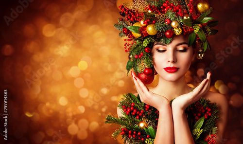 Recess Fitting Spa Christmas Face and Hands Skin Care, Woman Beauty Makeup, Art Wreath Hairstyle, Xmas Beautiful Portrait, Model looking to Product on Hand