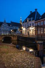 Dutch City Of Amersfoort At Night. Canal Behind Koppelpoort. Street Is Called Grote Spui And Kleine Spui.