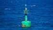 Lighthouse and buoy on Aegean sea coast