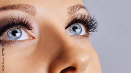 Obraz Woman eyes with long eyelashes and smokey eyes make-up. Eyelash extensions, makeup, cosmetics, beauty - fototapety do salonu