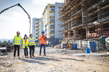 Group of construction workers on building site.Stock photo