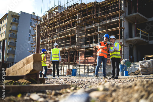 Group of construction workers on building site.Stock photo Lerretsbilde