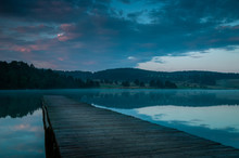 Wooden Jetty On Lake At Sunrise.
