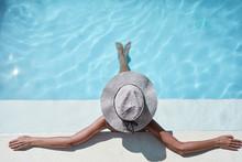 Enjoying Suntan And Vacation. Beautiful Young Woman In Swimming Pool.
