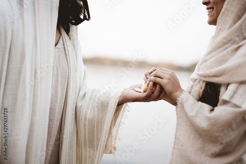 Fotografie, Obraz Scene - of Jesus Christ handing out bread with a blurred background