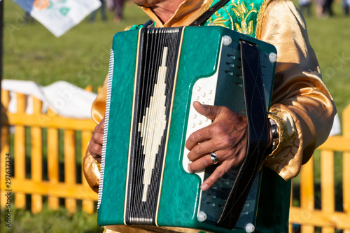 Fototapeta close up of a man's hands and the accordion he plays