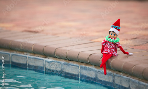 Christmas Elf lounging by the swimming pool celebrating time off Canvas Print