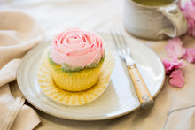 Vanilla Cupcake With Pink Fros...