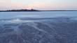 Backward flight away from salt lake surface at dawn